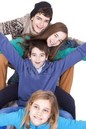 Photo pour Groupe de joyeux jeunes garçons sur fond blanc - image libre de droit