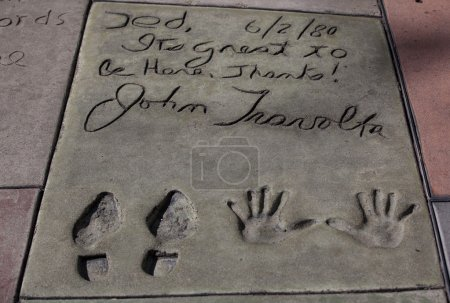 Photo for LOS ANGELES,CA-JULY 2,2011:John Travolta's autograph  in the Hollywood Walk of Fame,Los Angeles,July 2,2011 - Royalty Free Image