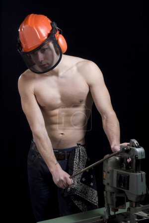Muscular worker with helmet
