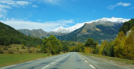 Empty road toward mountains inside Switzerland
