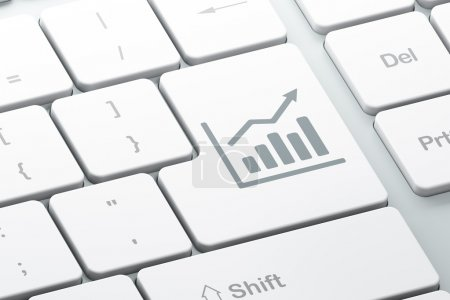Marketing concept: Growth Graph on computer keyboard background