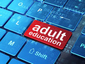 Education concept: Adult Education on computer keyboard backgrou