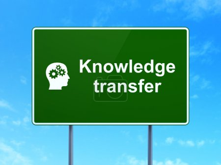 Education concept: Knowledge Transfer and Head With Gears on road sign background