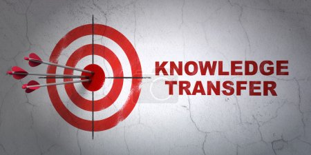 Education concept: target and Knowledge Transfer on wall background
