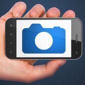 Koncepce cestovního ruchu: fotoaparát na smartphone