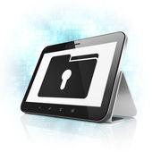 Podnikatelský koncept: složka s dírkou na počítači tablet pc