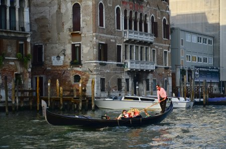VENICE, ITALY - MARCH 28: Tourists on a Gondola, March 28, 2012