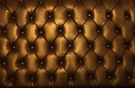 Luxury button decorated on brown leather use as high class background