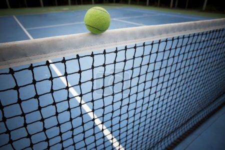 tennes ball over black net