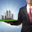 Business man and real estate in hand use for prope...