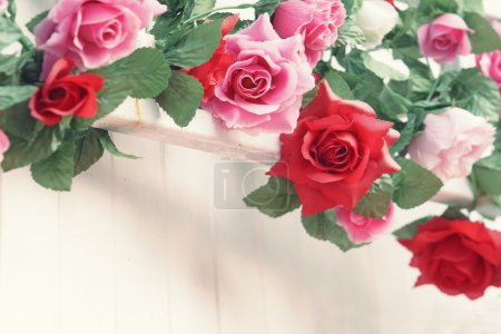 Roses  flower bouquet decorated on white wall with free copy space
