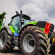 Giant farming tractor and plow in close-ups, lates...