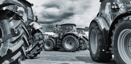 Large farming tractors lined up, latest models and...