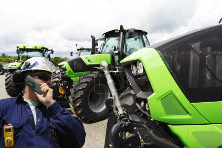 Mechanic and farming tractor line-ups