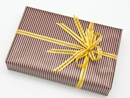 Black gift box with white bar attached gold ribbon...