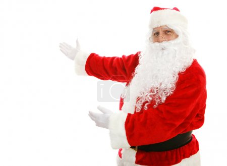 Photo for Santa Claus with his arms out in a presenting gesture. Isolated design element. - Royalty Free Image