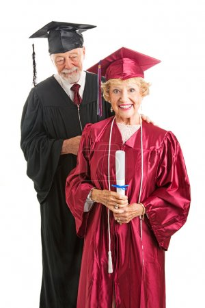 Photo for Senior woman graduate holding the diploma she just got from her professor. Isolated on white - Royalty Free Image
