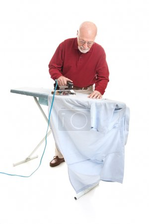 Senior Man Irons His Shirt