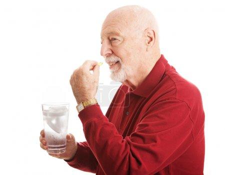 Senior Man - Taking Fish Oil