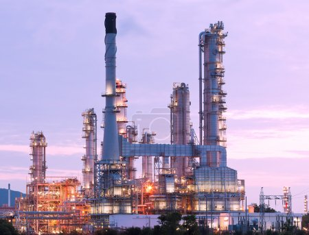Photo for Scenic of petrochemical oil refinery plant shines at night, closeup - Royalty Free Image