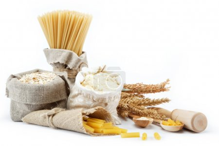 Flour, cereals, pasta in a canvas bag and ear on white backgroun