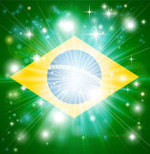 Flag of Brazil background with pyrotechnic or light burst and copy space in the centre