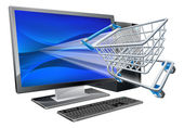 Desktop computer with super market shopping cart trolley flying out of screen online shopping concept