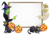 Halloween sign or banner with orange Halloween pumpkins and black witch's cats witch's broom stick and cartoon witch and mummy character