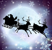 Santa flying in his sleigh with reindeer in front of a full moon in silhouette