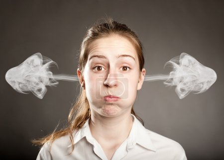 Photo for Young businesswoman with smoke on her ears - Royalty Free Image