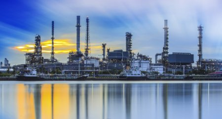 Photo for Refinery industrial plant with river and sunset - Royalty Free Image