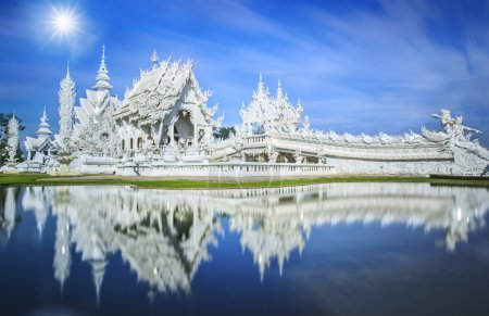 Photo for Magnificently grand white church and reflection in the water, Rong Khun temple, Chiang Rai province, northern Thailand - Royalty Free Image