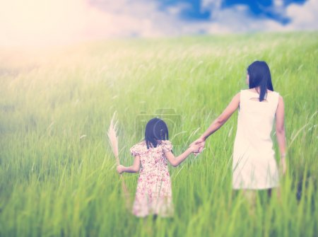Photo for Mom and daughter runing in nature background - Royalty Free Image