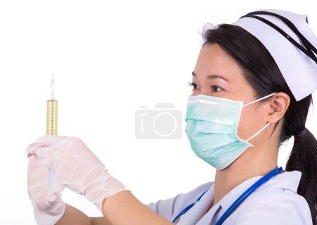 Nurse with medical syringe