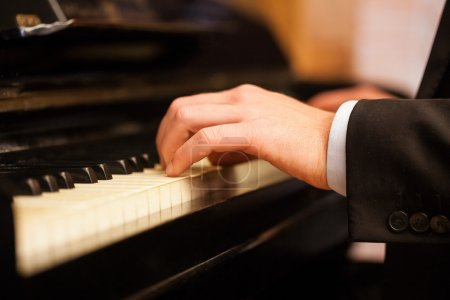Photo for Close up of a musician playing a piano keyboard - Royalty Free Image