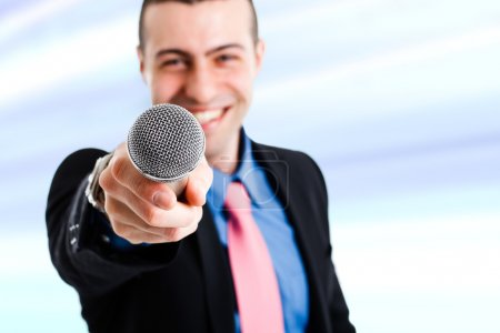 Man holding a microphone