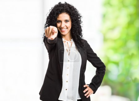 Photo for Portrait of a smiling beautiful woman pointing her finger at you - Royalty Free Image