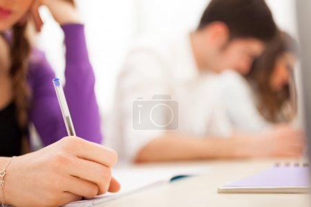 Photo for Female student at work - Royalty Free Image