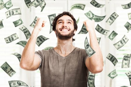 Photo for Portrait of a very happy young man in a rain of money - Royalty Free Image