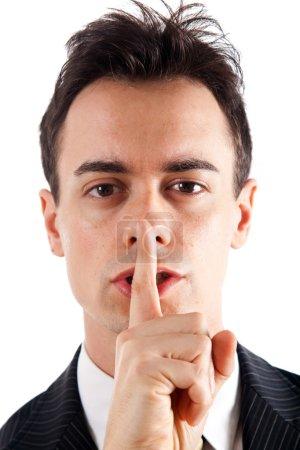 Photo pour Un homme d'affaires demande silence. isolé sur blanc. - image libre de droit