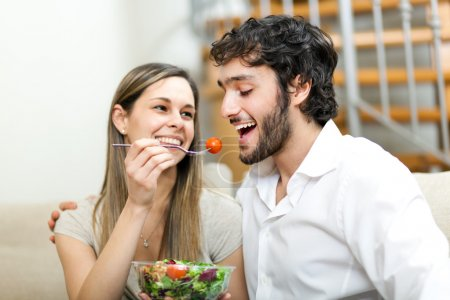 Photo for Woman lovely feeding her boyfriend - Royalty Free Image