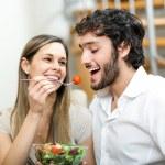 Woman lovely feeding her boyfriend...