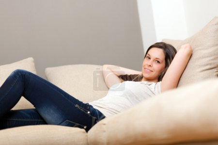 Young woman relaxing on the sofa