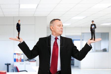Businessman choosing a new employee