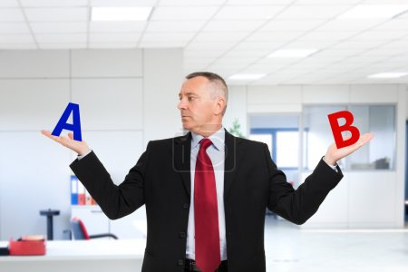 Confused businessman trying to make a decision