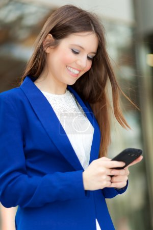 Portrait of a beautiful woman using a cell phone