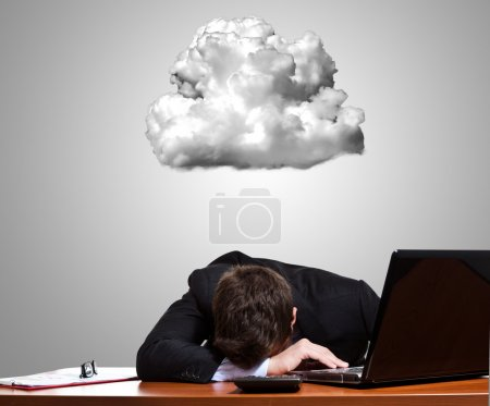 Photo for Worried and stressed businessman lying on his desk - Royalty Free Image