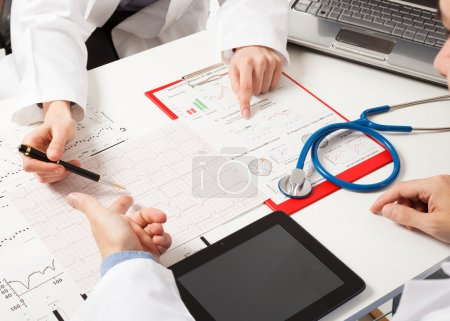 Photo for Doctors examining medical tests - Royalty Free Image