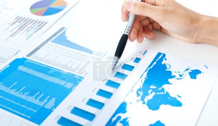 Photo for Examination of a stock market report - Royalty Free Image