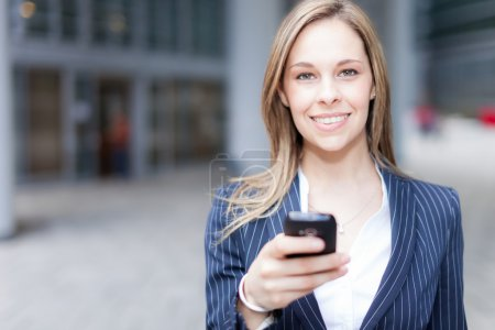 Photo for Portrait of a beautiful woman using a cell phone - Royalty Free Image